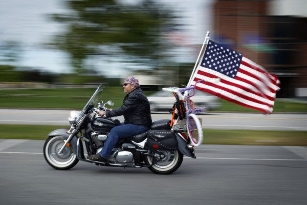 Fulton Oakes of Wiscasset arrived in Augusta for the start of the 30th annual toy run, Sunday, Sept 11, 2011. The two bicycles tied on under the flag were among the thousands of toys collected by bikers to be distributed to children throughout the state at Christmastime.
