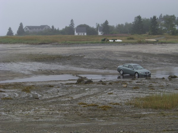 At low tide, locals Down East don't hesitate to take cars out on the mudflats. This dirt road becomes flooded at high tide by a long inlet, leaving locals stranded on either side.