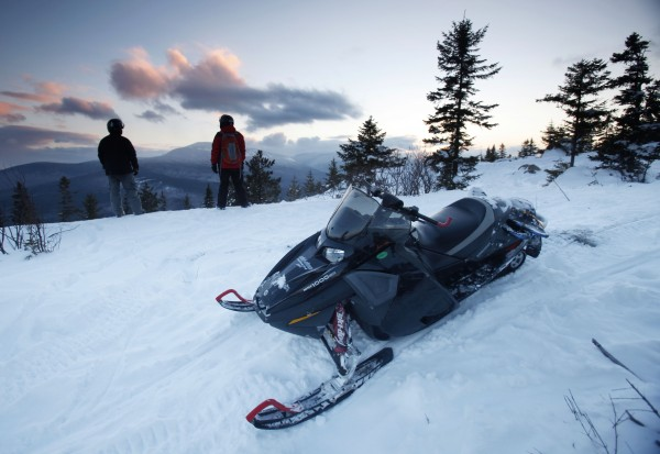 Snowmobilers take in the scenery on a parcel of land sandwiched in between land owned by conservationist Roxanne Quimby in Township 5, Range 8 on Jan. 28, 2011.