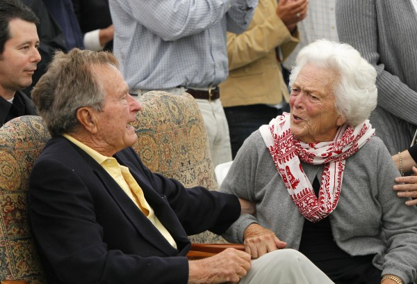 Former President George H. W. Bush and former first lady Barbara Bush chat at a ceremony to unveil a new garden named in Barbara's honor, Thursday, Sept 29, 2011, in Kennebunkport.