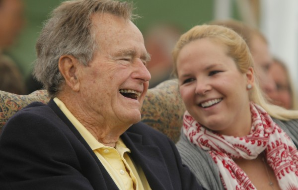 Former President George H. W. Bush laughs with his grandaughter Marshall Bush while attending a ceremony to unveil a new garden named in his wife Barbara's honor, Thursday, Sept 29, 2011, in Kennebunkport. A local group donated Ganny's Garden — Barbara Bush's grandchildren call her Ganny —– on  the town green. It features flowers, greens and 17 trees in honor of the Bushes' 17 grandchildren.