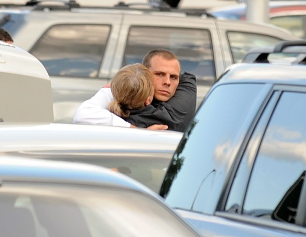 Garrett Cheney is hugged by a woman in the parking lot of the Penobscot Judicial Center in Bangor on Thursday, July 28, 2011. Cheney is moving to overnturn his conviction.