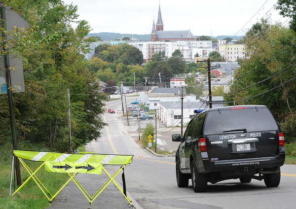 A Lewiston Police vehicle is parked in the middle of Bartlett Street in Lewiston on Friday morning in the area where 19-year-old Andrew Jackson reportedly died as a result of drug use.