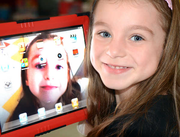Sophia Sansoucy shows off her portrait on a new Apple iPad in her kindergarten class at Washburn Elementary School in Auburn on Wednesday, Sept. 7, 2011.