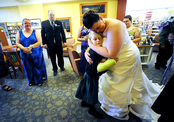 Alicia Proulx hugs her soon-to-be stepson, Draven Fiori, as her parents, Cathy and Reggie Proulx looked on at the Auburn Public Library on Saturday evening before her wedding to Jared Fiori.