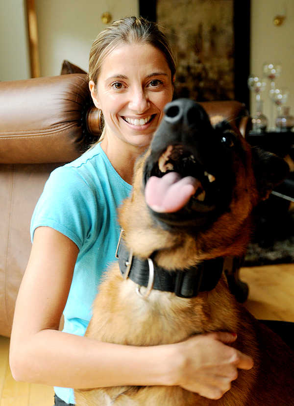 Lisa Nazarenko of Bowdoin has formed Lost Pet Tracking Dogs, a business that specializes in finding missing dogs and cats. Dante, one of Nazarenko's four trained dogs that she uses to track lost pets, is pictured with Nazarenko.