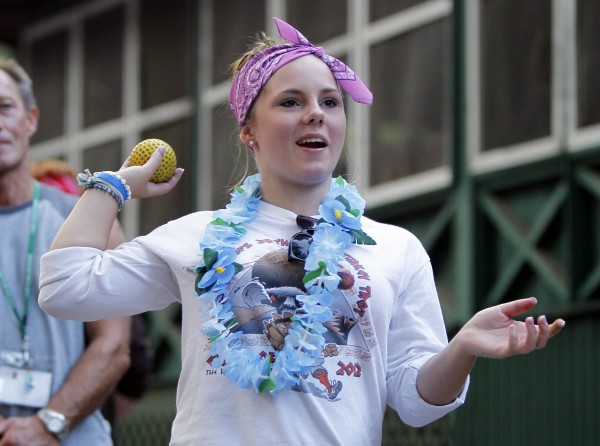 Jasmine Coulter tosses a ball in a carnival game at Camp To Belong in South Waterford, Maine.