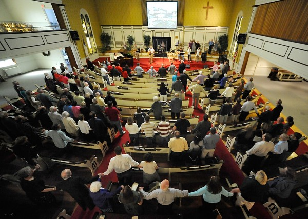 At the end of Sunday's service at Columbia Street Baptist Church to describe the Celebrate Recovery movement, worshippers from at Columbia Street Baptist Church and New Hope Church in Bangor join hands.