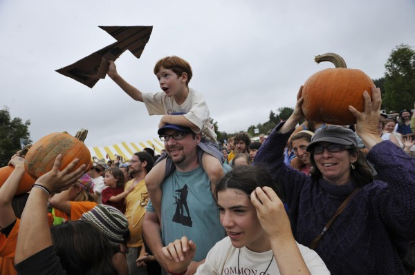 "Sitting on the shoulders of his father, Jim Dowd, Treely Dowd, 6, shouts environmental slogans as the Dowd family joined hundreds of others for the 350.org ""Moving Planet"" climate action event at the Common Ground Country Fair on Saturday afternoon, Sept. 24, 2011. Nearby were Treely's sister Rebecca Dowd (lower right) and their mother Bo Abrams (upper right), all of Gloucester, Mass. 350 represents the parts per million of carbon that the earth's atmosphere can safely accomodate, according to 350.org."