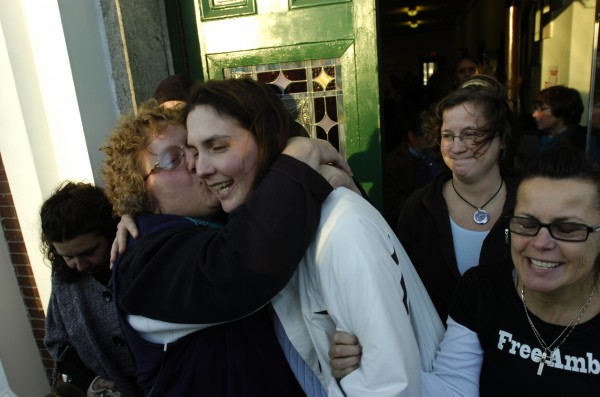 Paula Streubel (left) gives Amber Cummings a hug and a kiss as she leaves the Waldo County Courthouse in Belfast on Thursday, Jan. 7, 2009. Clutching Cummings' arm is her cousin Chary Jopes (right). Cummings received an 8-year suspended sentence in the December 9, 2008 shooting death of her husband, James Cummings, at their High Street home in Belfast.
