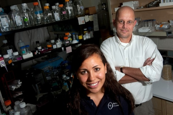 Student Alexa Dantzler and professor Paul Roepe are part of a team that found that a dry cleaning solvent is retained in clothes.