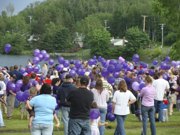 More than 100 people attended a gathering in June 2011 at the Lake Wassookeag public beach for domestic violence awareness. Purple balloons were launched by the attendees in remembrance of Amy, Coty and Monica Lake who were killed by Amy's husband Steven Lake, the father of their children.