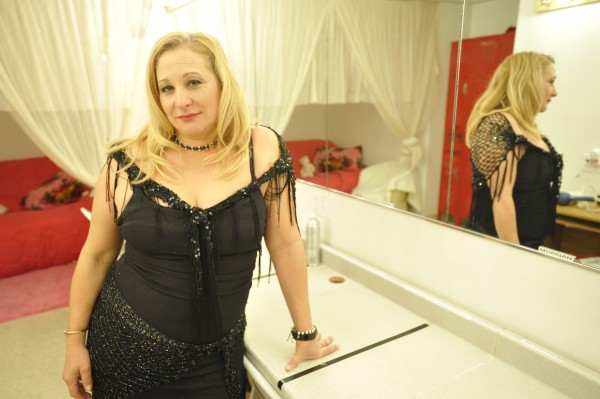 Diva's Gentleman's Club owner Diane Cormier stands in the performers' changing area of her Bangor nightclub in October 2010.