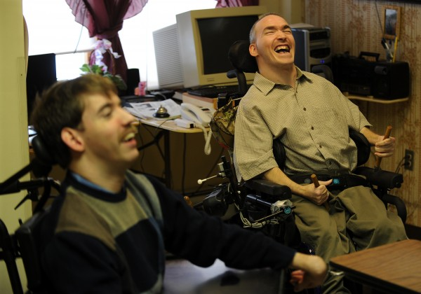 Eric Reeves (right) makes a joke during an interview at Penobscot Nursing Home in 2009. Reeves and fellow nursing home resident Jake Van Meter sued the state because their only living option is the nursing home.