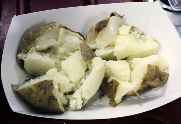 In this Sept. 14, 2011 photo, baked potatoes are displayed in a dish during lunch at Gardiner High School in Gardiner. New guidelines proposed by the U.S. Department of Agriculture would eliminate potatoes altogether from school breakfasts and drastically reduce the amount of potatoes served in lunches.