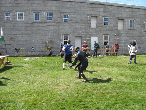 Two men engage in a fencing match last year at the annual medieval tournament at Fort Knox in Prospect.