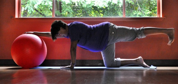 Leela Payne performs a yoga pose. Countless moms-to-be are exercising.