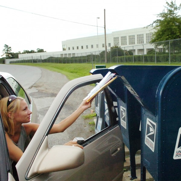 Hampden resident Crissy Rowe drops off mail in a post office box outside the U.S. Postal Service Eastern Maine Processing and Distribution Facility in Hampden in August 2008.