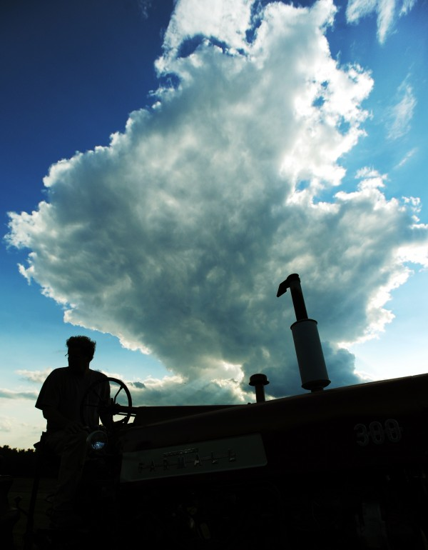 With concerns about posible rain showers, Jeff Kelman keeps his eye on the baler as he hays his fields in Glenburn on Monday, Sept. 12, 2011.