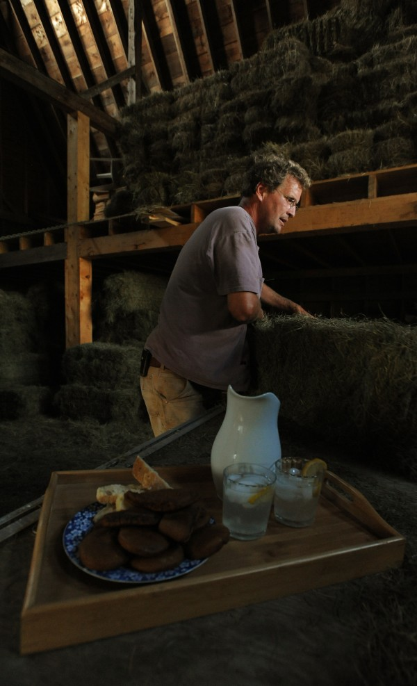 A tray of homemade snacks and lemonade sits on the hay wagon waiting for tired family members to take a break after a long day haying on Monday, Sept. 12, 2011.