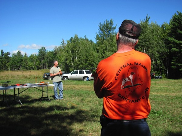 Northern New England Brittany Club member Steve Belletti describes what occurs during a hunt test. The hunt test instructor explained the differences between hunt tests and field trials.