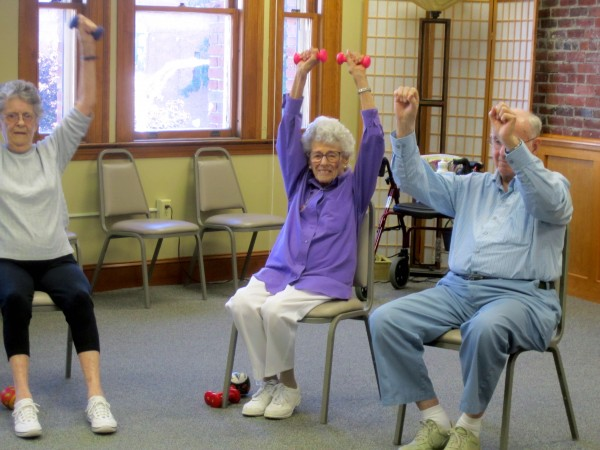 Elizabeth Siegel, aka Queen Elizabeth, working out in exercise class at the Hammond Street Senior Center.