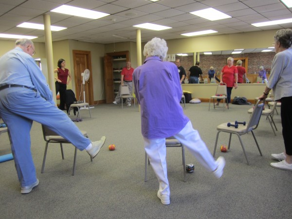 Queen Elizabeth, in purple (her favorite color), working out with her class at the Hammond Street Senior Center.