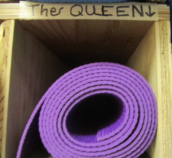 Cubby that stores The Queen's yoga mat (a purple one, of course).