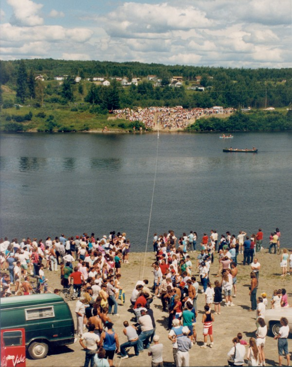 During the Festival des Deux Rives, in 1989, members of local service clubs and community organizations in Van Buren (foreground) competed in tugs-of-war against their counterparts across the St. John River in St. Leonard, New Brunswick. Judges in a canoe in the middle of the river declared the winners by raising the appropriate national flag after each victory. The losers got wet.