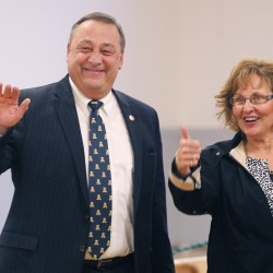 Gov. Paul LePage and his wife, Ann, acknowledge well-wishers before voting in Waterville in November 2010. The couple has been invited as special guests at the Maine National Guard's Sexual Assault & Domestic Violence Prevention event, scheduled for Wednesday evening at the Waterville Grand Hotel.