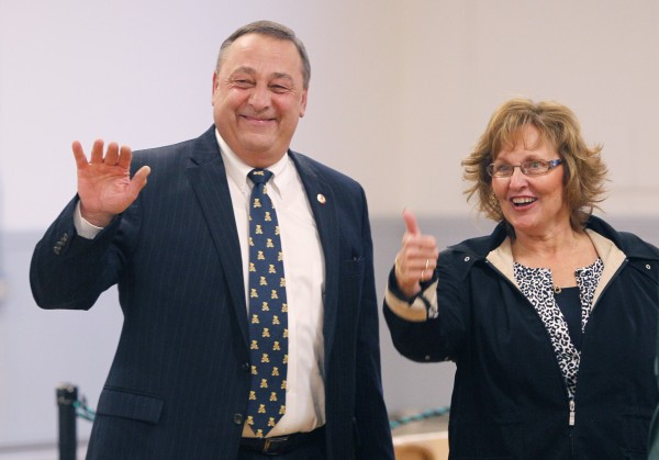 Gov. Paul LePage and his wife, Ann, acknowledge well-wishers before voting in Waterville in November 2010.