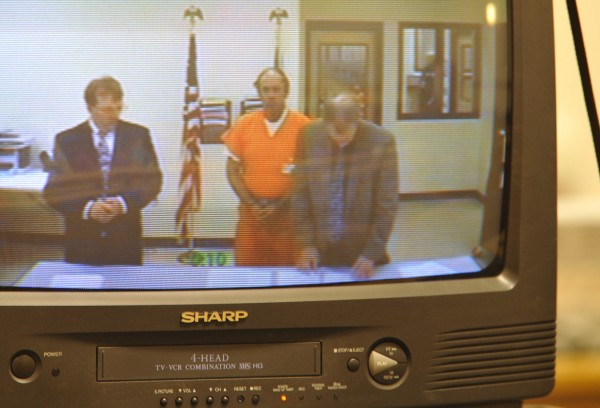 Standing next to attorneys, Jay S. Mercier (center) made his initial appearance at Skowhegan District Court via video Friday afternoon, Sept. 30, 2011. With the help of modern forensic science, prosecutors had a break in the 31-year-old homicide case. Mercier was arrested Wednesday and charged  with the murder of Rita St. Peter whose body was found in Anson in 1980.