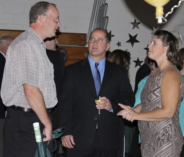 Spencer Bragan (left), a 1991 graduate from Northern Maine Community College's residential construction program, was among the 50 stars recognized during NMCC's 50th Anniversary Gala on Saturday, Sept. 10, 2011.  Bragan, who served as a resident assistant at the College, and his wife Tricia had the chance to catch up with Thomas Richard, NMCC director of residential life, during the social preceding the Gala.