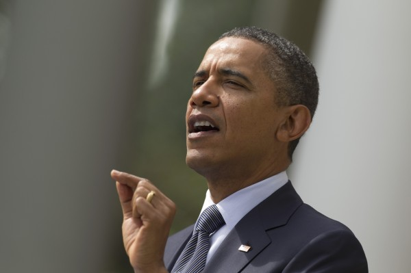 President Barack Obama gestures while speaking in the Rose Garden of the White House in Washington, Monday, Sept. 19, 2011.