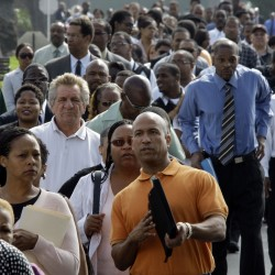 In this Aug. 31, 2011 file photo, some of an estimated 4,000 people wait to enter a job fair in South Los Angeles. (AP Photo/Reed Saxon, File)