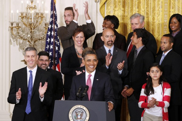 President Barack Obama stands with educators and students as he speaks about No Child Left Behind Reform, Friday, Sept. 23, 2011, in the East Room of the White House in Washington.