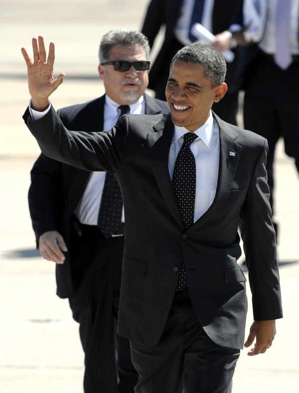 President Barack Obama waves to a crowd of supporters at his arrival at Marine Corps Air Station Miramar, in San Diego, Monday, Sept. 26, 2011.