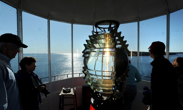 People enjoy the view from the Owls Head Lighthouse during the 3rd annual Open Lighthouse Day Saturday.  The U.S. Coast Guard, the State of Maine and the American Lighthouse Foundation coordinates the day and opens up over 20 lighthouses to the public for the day.