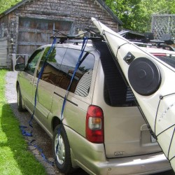 To make loading a kayak on the roof of your vehicle, put a non-slip pad on the vehicle, then lift the bow of your boat up to sit on the pad. Next go to the stern, lift and push the boat onto the racks.