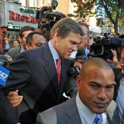 Republican presidential candidate Texas Gov. Rick Perry, center, heads to his vehicle after exiting the Papasito Restaurant in the Inwood section of the Manhattan borough of New York, Monday, Sept. 19, 2011.