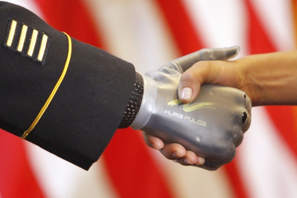 Army Sgt. First Class Leroy Arthur Petry, left, recipient of the Medal of Honor, shakes hands in a receiving line after being honored by the New Mexico Congressional Delegation during a ceremony on Capitol Hill in Washington, Tuesday, Sept. 13, 2011.