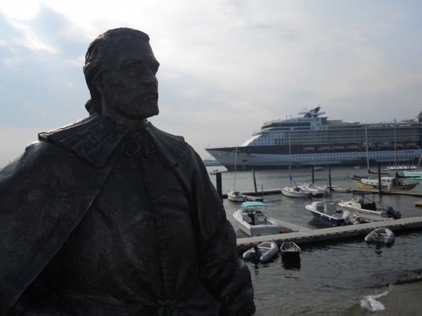 A statue of George Cleeve, who established a permanent settlement in the 1630s that later became the city of Portland, stands watch near Portland's new Pier II earlier this month. Docked is the Celebrity X Cruise ship.