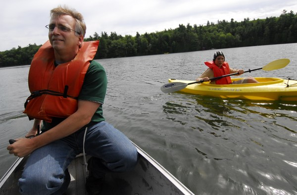 The Rev. Bryan Breault, director of Pilgrim Lodge in West Gardiner, and camper Jamie Faunce of Gorham, paddle Pinkham Sound in August 2007. In the wake of multiple kayaker deaths this summer, State Rep. Richard Malaby of Hancock is proposing a new law that would require paddlers to wear life jackets while out on the water.