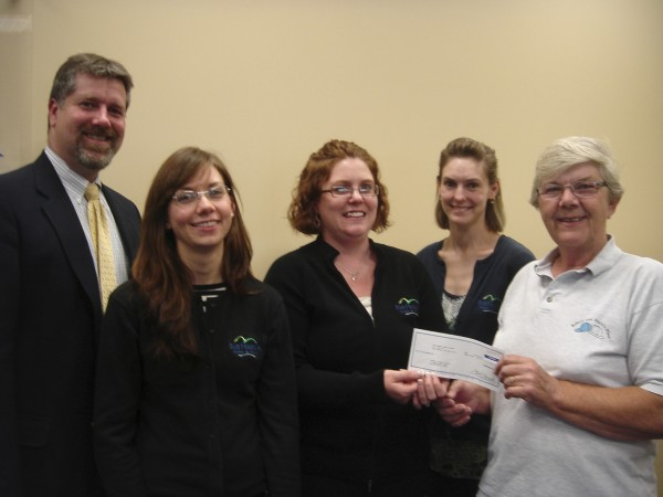 Pictured (left to right) are Bar Harbor Bank & Trust Ellsworth branch employees Chris Young, Jenn Tucker, Jody McFadden and Theresa Ellis presenting a Community Commitment donation to Ida Page, Executive Director of Robert and Mary''s Place in Ellsworth, that serves those with memory loss. Other Ellsworth branch employees unavailable for the photo include Marlene Lloyd, Jennifer Norton, Anna Minctons, Lacy Linscott and Gabriella Magee.