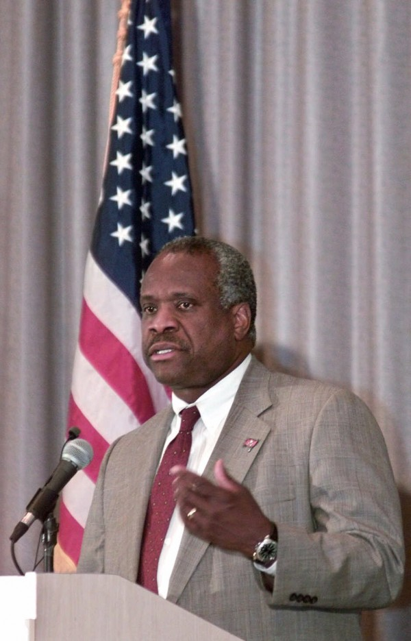 U.S. Supreme Court Justice Clarence Thomas speaks at the annual spring lunch hosted by the Tampa Bay Federal Bar Association in Tampa, Fla., on April 4, 2000. The U.S. Supreme Court ordered a temporary halt Saturday, Dec. 9, 2000.