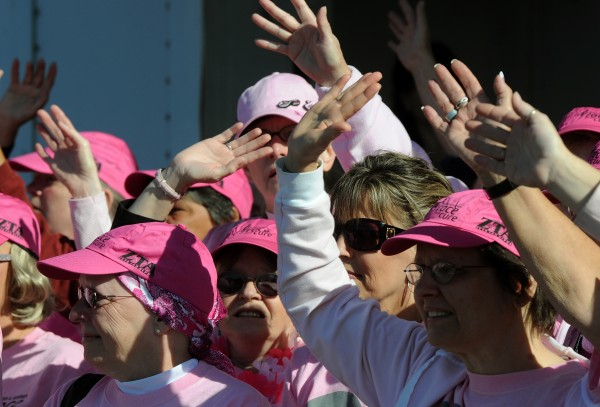 Breast cancer survivors wave to the thousands of people who gathered for the 13th annual Susan G. Komen Race for the Cure during the survivor ceremony on the Bangor Waterfront in September 2009. The 15th annual race will begin 10 a.m. Sunday, Sept. 18, on the Bangor Waterfront.