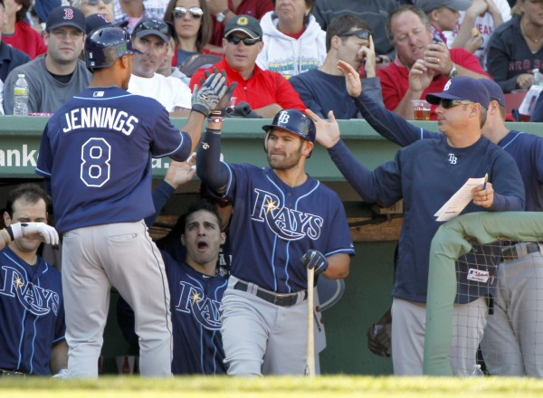 Tampa Bay Rays' Desmond Jennings (8) high-fives with teammate Johnny Damon, center, after scoring on a passed ball by Boston Red Sox's Jarrod Saltalamacchia in the fifth inning  Sunday, Sept. 18, 2011.