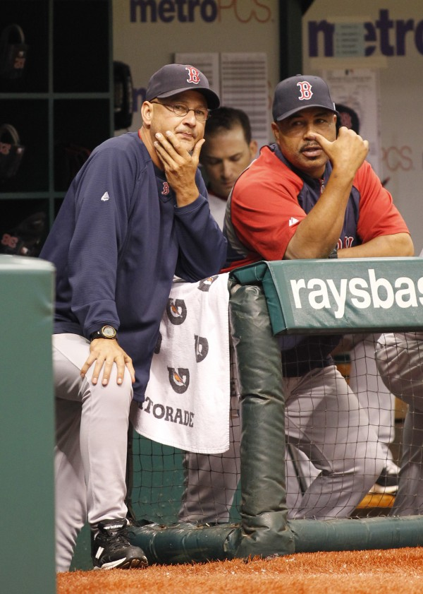 Boston Red Sox manager Terry Francona, left, and bench coach DeMarlo Hale look on during their team's 9-1 to the Tampa Bay Rays on Sunday, Sept. 11, 2011, in St. Petersburg, Fla. The Rays won 9-1.