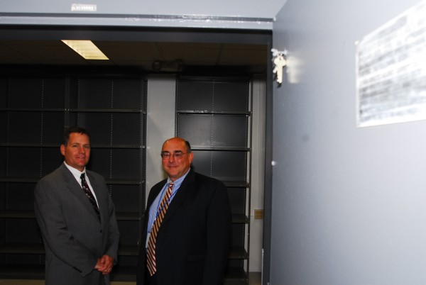 Oxford Networks CEO Craig Gunderson (left) and Resilient Tier V President and Chief Scientist Charles Largay stand in one of the secure records rooms at the startup's headquarters in the former Brunswick Naval Air Station on Wednesday, Sept. 21, 2011.