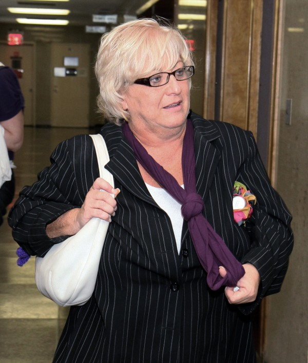 Barbara Sheehan leaves the courtroom in Queens State Supreme Court as her trial breaks for the day, in New York on Friday, Sept, 23, 2011. Sheehan is accused of fatally shooting her retired police officer husband. Sheehan has pleaded not guilty saying the shooting was in self-defense.